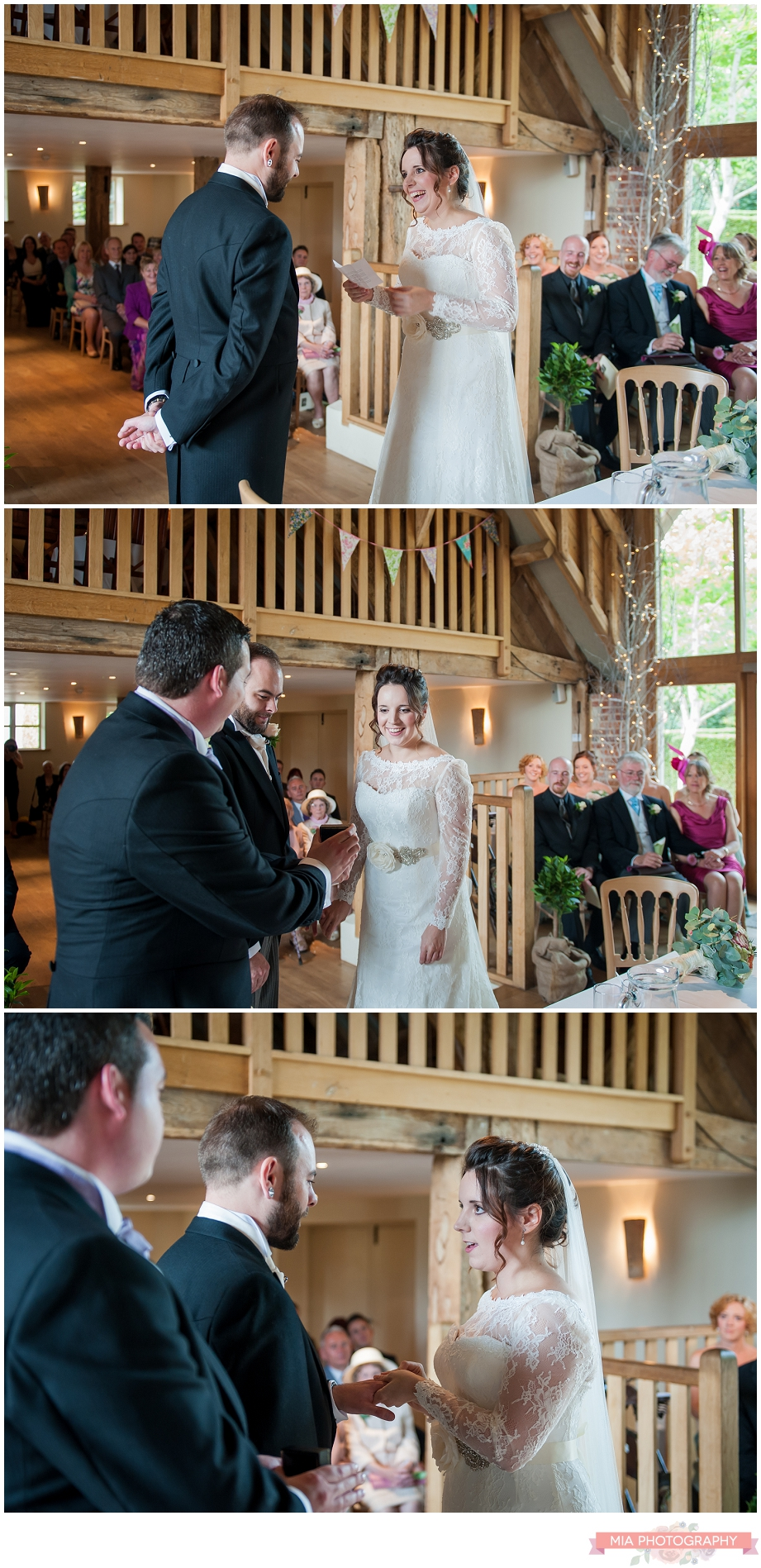 couple saying their vows at bury court barn in hampshire