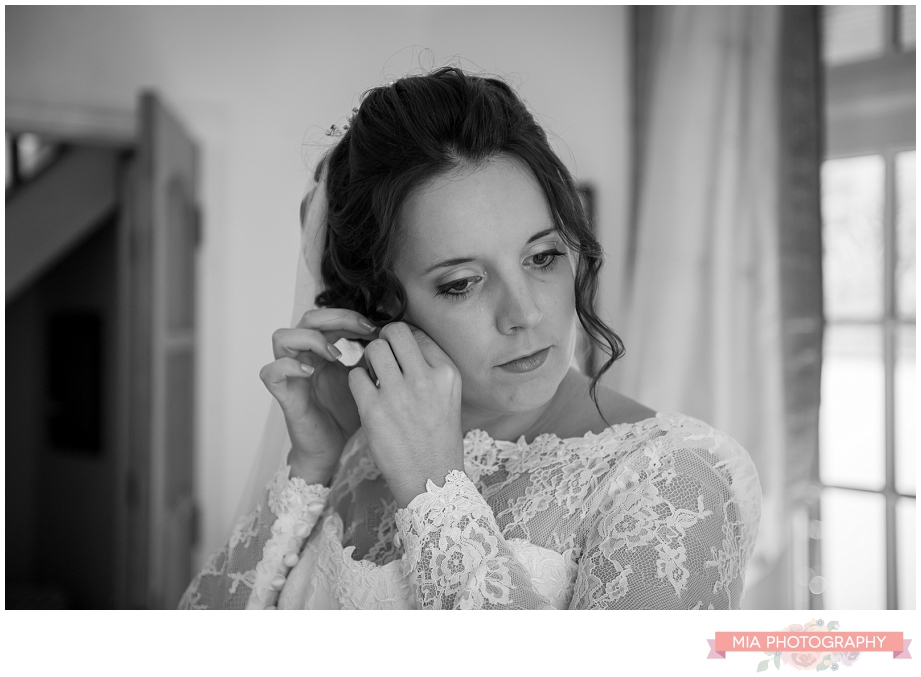 bride dressing for her wedding in hampshire