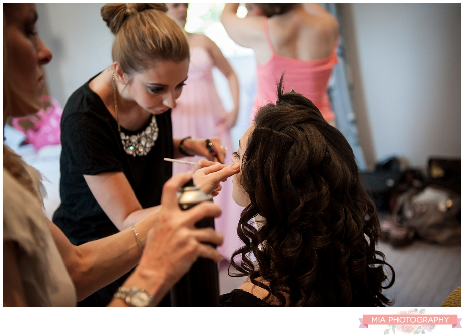bride having her make up done at oakley hall
