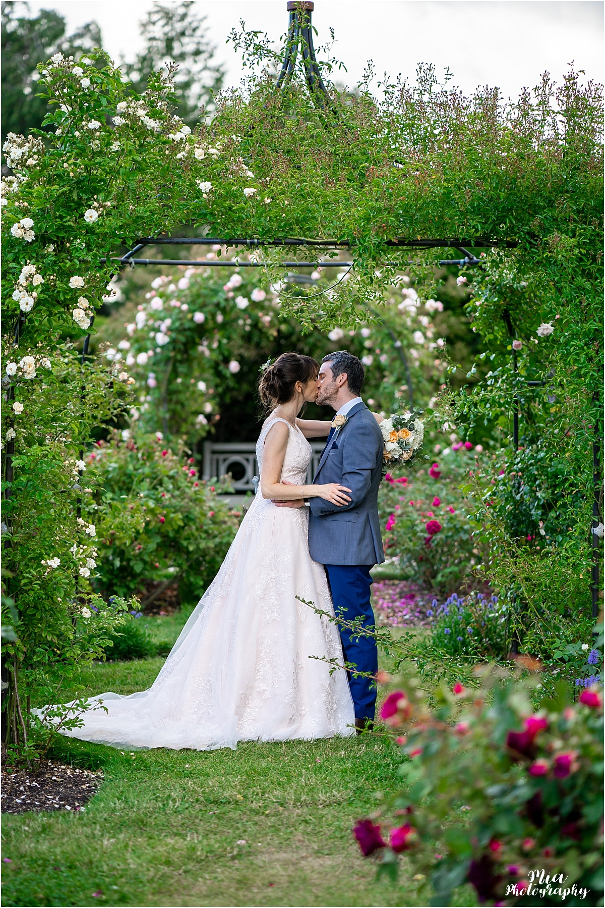Bride and groom in the roses